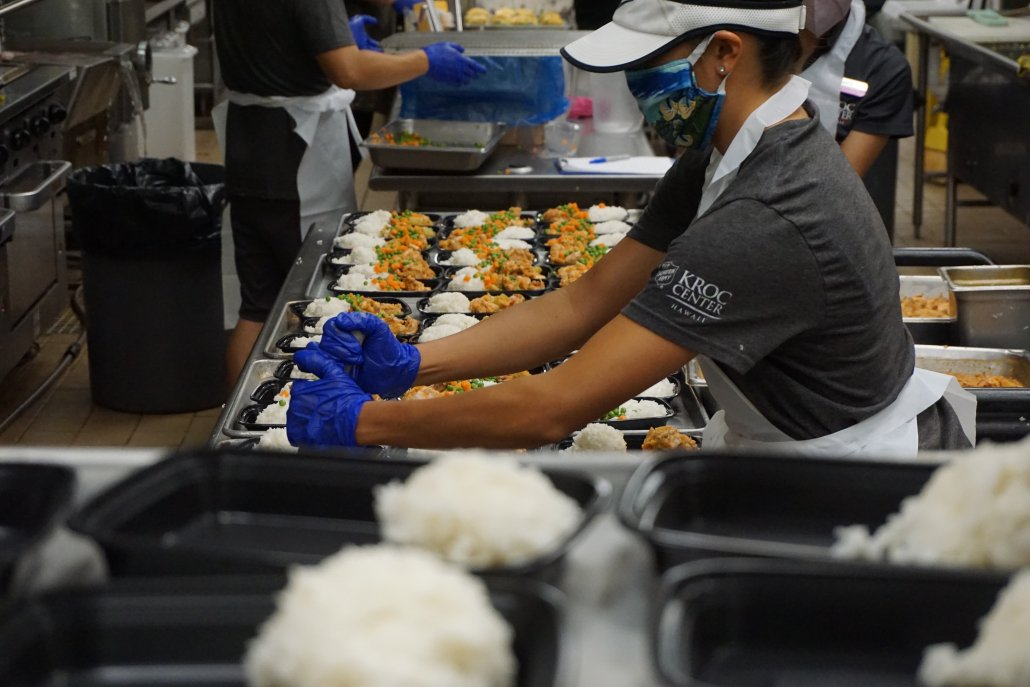 Individual preparing meals in kitchen