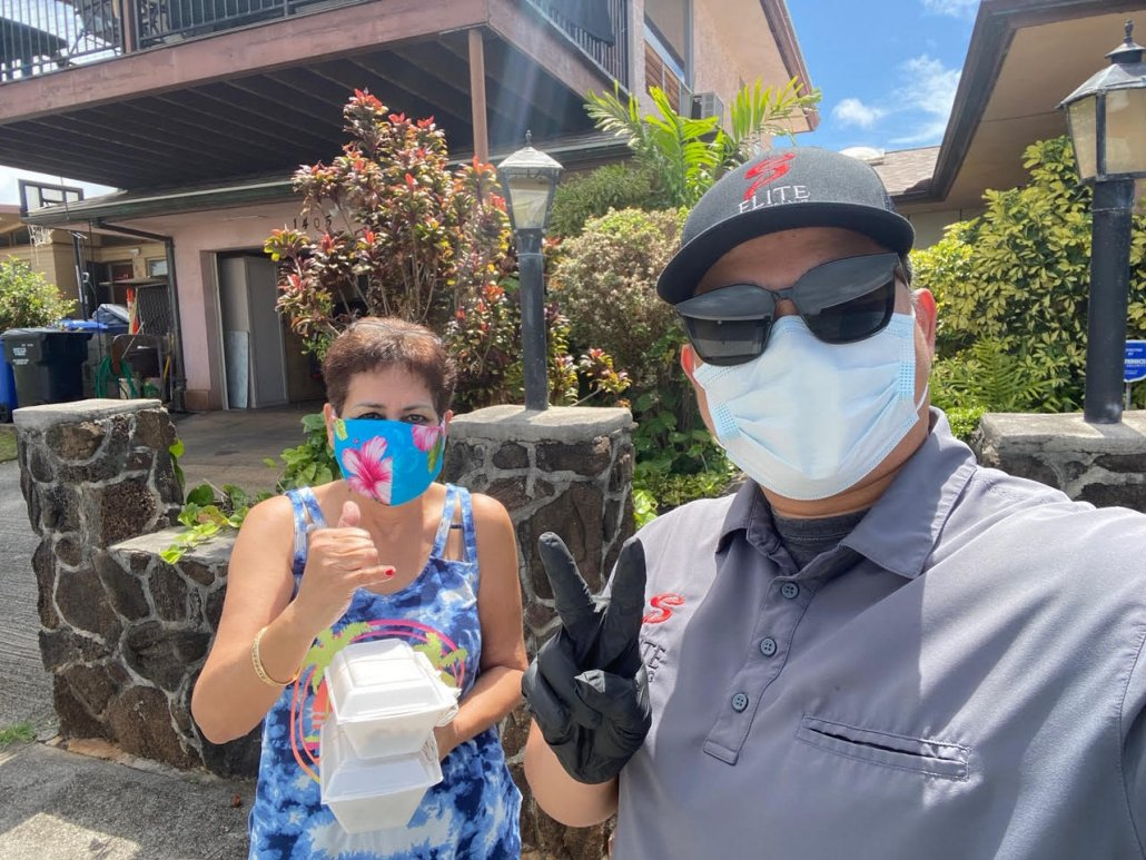 KFSC partner and kupuna receiving food delivery
